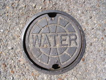 Water Utility Cover. Slightly rusted water utility cover Stock Images