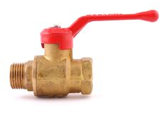 The water valve. From a brass with the red handle on a white background Royalty Free Stock Images
