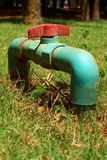 Water valve on a grass background Stock Photography