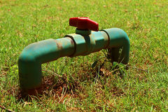 Water valve on a grass background Royalty Free Stock Image
