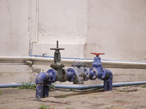 Water valve near building Stock Photography