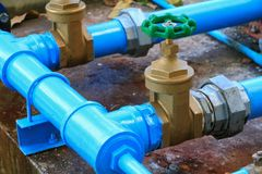 Water valve plumbing joint steel tap pipe with green knob close up.  royalty free stock photo