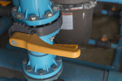 Water valve in swimming pool. Stock Photos