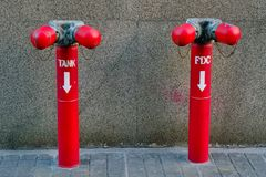 A water valve tank and FDC Fire Department Connection . A red pipe of water valve tank and FDC Fire Department Connection at the outside of building royalty free stock photos