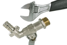 Water valve and wrench Stock Image