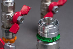Water valves with fittings on grey Stock Photos