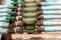 Water Valves and Old Water meters Royalty Free Stock Photos