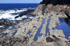 Water in Van angst verstijfd Zand langs de Kust van Oregon Stock Fotografie