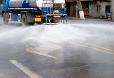 Water van watering the road Royalty Free Stock Photos