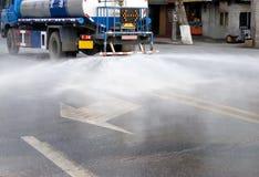 Water van watering the road. A water van is watering a asphalt road,water distributing Royalty Free Stock Photos