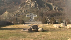 Water and Vanga Stone cross on the mountain in the Rupite, Bulgaria. Temple of Saint Petka built Vanga, Bulgarias tourist attractions, a place of pilgrimage for stock footage