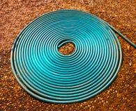 Water vattnar med slang texturerar Royaltyfri Foto