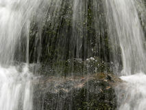 Water veil. Detailed view of the waterfall Stock Image