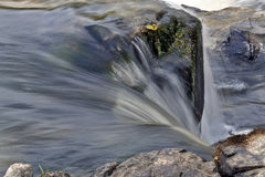 Water veil falling on the rocks Royalty Free Stock Photos