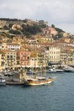 Water view of colorful buildings and harbor of Portoferraio, Province of Livorno, on the island of Elba in the Tuscan Archipelago  Stock Photography