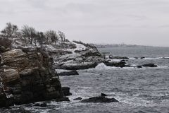 Fort Williams Park, Cape Eiizabeth, Cumberland County, Maine, United States New England US. Water view at Fort Williams Park on a cold cloudy blustery snowy royalty free stock photos