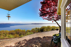 Water view from the house back yard with red maple. Brick porch royalty free stock images