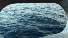 Water view from the porthole of the yacht in Maldives. stock footage
