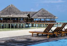 Water Villa at beautiful tropical Maldive island beach resort. Beautiful tropical Water Villas at Maldive beach resort hotel for holiday background Royalty Free Stock Images