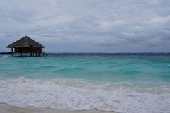 Water villa, cloudy sky and the Indian Ocean in cloudy weather. Maldives royalty free stock photos
