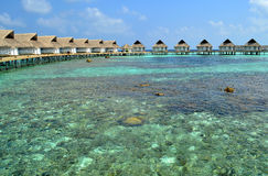 Water Villa on the cystal water. Water Villas on the cystal water and blue sky Stock Photo