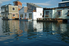 Water village. Homes on the water are one of the tourists� attractions. Shot made from the back side of the buildings, connected with a pontoon that used as Royalty Free Stock Image