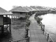Water village resort. A black and white dreamy view of a water village resort Royalty Free Stock Image