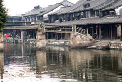 Water Village Xitang. The old town district nine rivers and intertwined, the town is divided into eight blocks, in which 27 Old Bridge town connectivity. Ancient Stock Photos