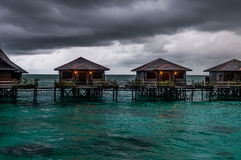 Water villas during bad weather. A shot of water villas in Sabah Malaysia during bad weather Royalty Free Stock Photos