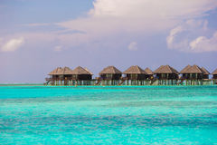 Water villas, bungalows on ideal perfect tropical Royalty Free Stock Photography