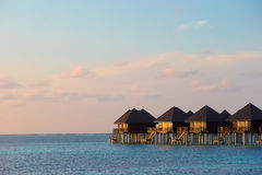 Water villas, bungalows on ideal perfect tropical Stock Image
