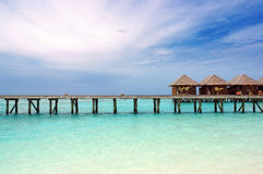 Water villas and jetty on maldives Royalty Free Stock Photos