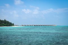 Water villas on Maldives island in the nice morning royalty free stock photography