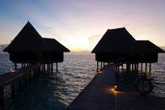 Water villas on Maldives by sunset Royalty Free Stock Photo
