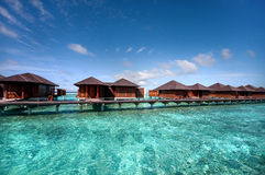 Water villas at Maldivian resort Royalty Free Stock Photos