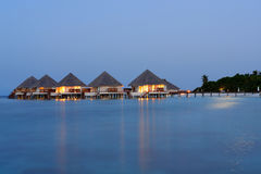Water villas by night Stock Photos
