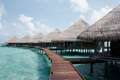 Water Villas in The Ocean. Royalty Free Stock Photo
