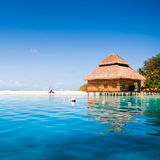 Water villas in the ocean. With steps into turquoise lagoon Royalty Free Stock Images