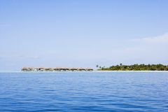 Water villas from ocean side. Clear blue sky stock photos