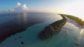 Water villas in the ocean with steps into turquoise lagoon, Kuredu, Maldives stock video