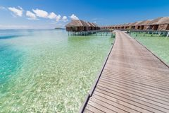 Beautiful tropical Maldives resort hotel and island with beach and sea on sky for holiday vacation background concept
