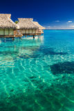 Water villas over tropical reef Royalty Free Stock Image