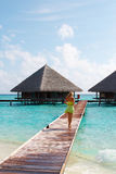 Water Villas and sexy Lady. Royalty Free Stock Photo