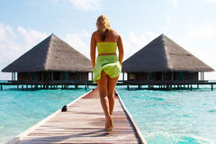 Water Villas and sexy Lady. Stock Photos