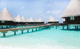 Water villas on tropical island on Maldives Royalty Free Stock Photos