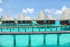 Water villas on tropical island on Maldives Royalty Free Stock Photos