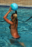 Water Volleyball. A girl with a ball in the pool playing volleyball Royalty Free Stock Photo