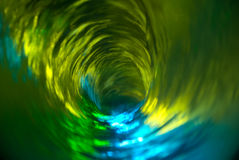 Water Vortex 1. Looking down into a swirling multi-colored water vortex stock photography