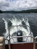 Water wake behind outboard motor Stock Image