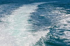 Motor boat water wake.Water track on beautiful blue ocean surface behind moving speedboat. stock photography